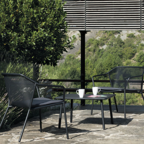 black lounge chair and black coffee table outdoors