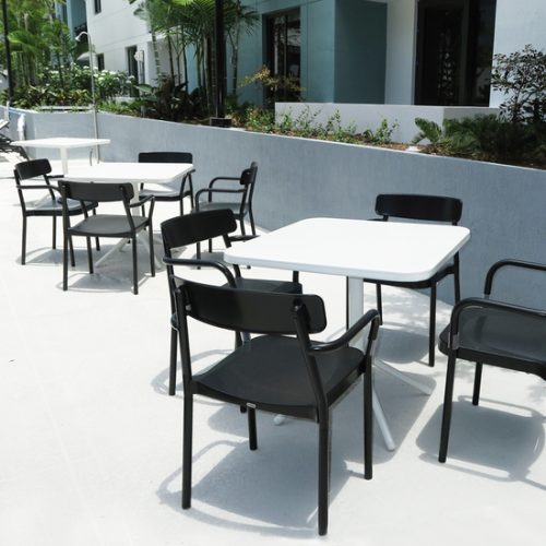 outdoor white tables and black armcharis