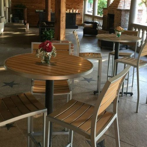 teak barstools and tables in restaurant bar area