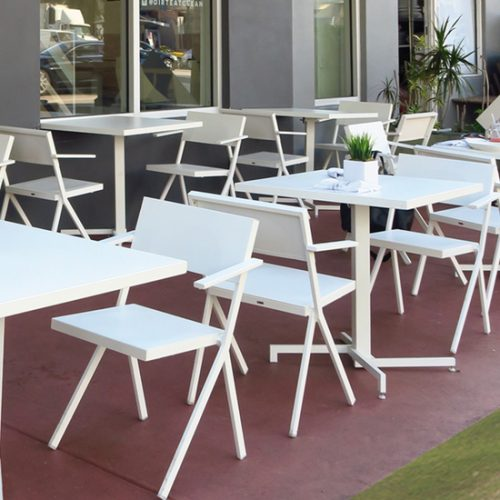 white outdoor armchairs and tables