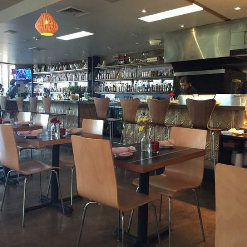 wood shell chairs and table top in restaurant