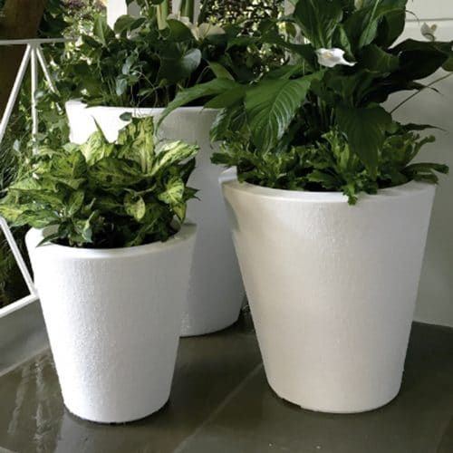 white planters with braille texture